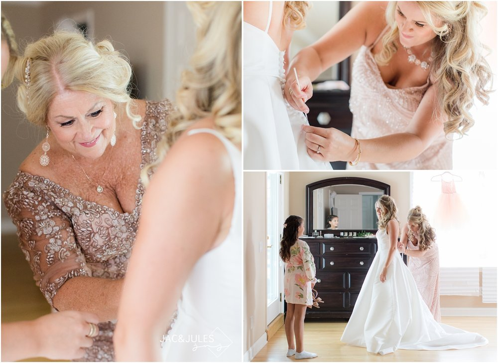 bride getting dressed for her wedding at home in Spring Lake, NJ.