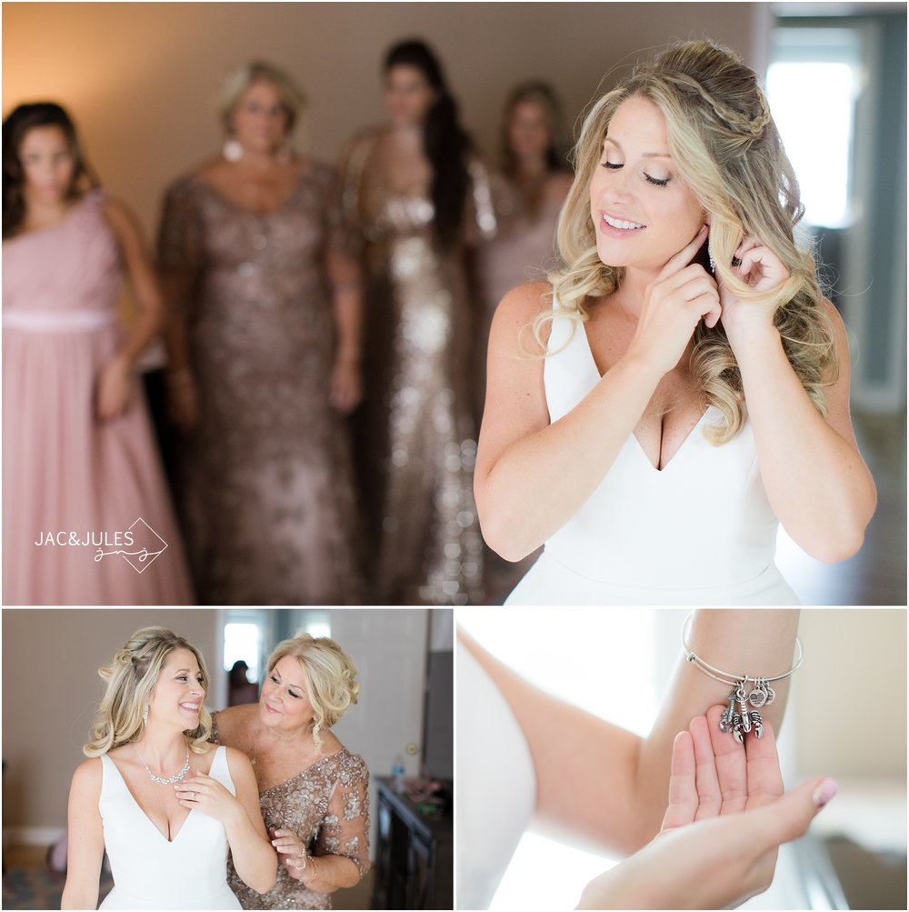 Bride putting on jewelry at home in Spring Lake, NJ.