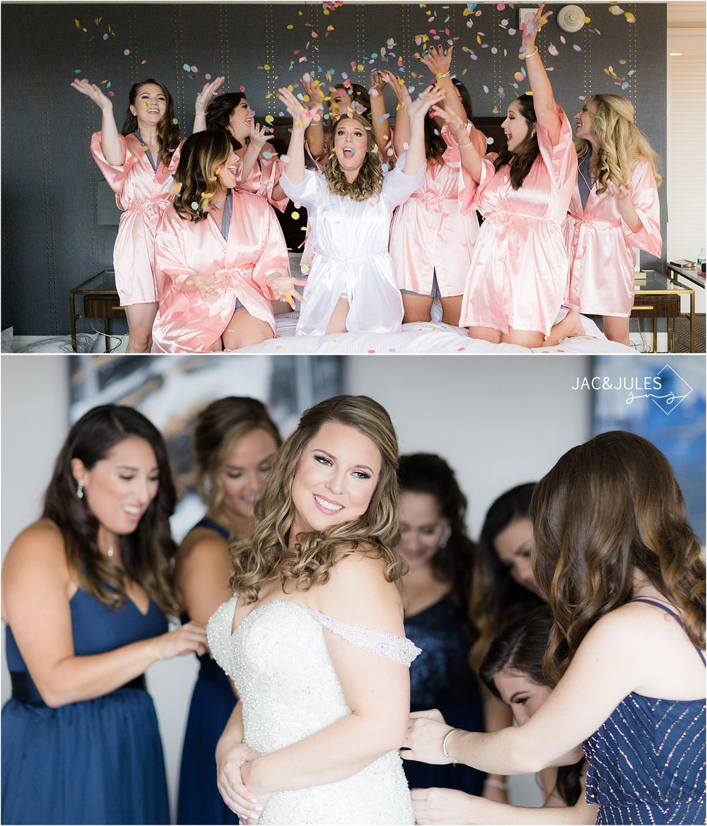 bride and bridesmaids throw confetti