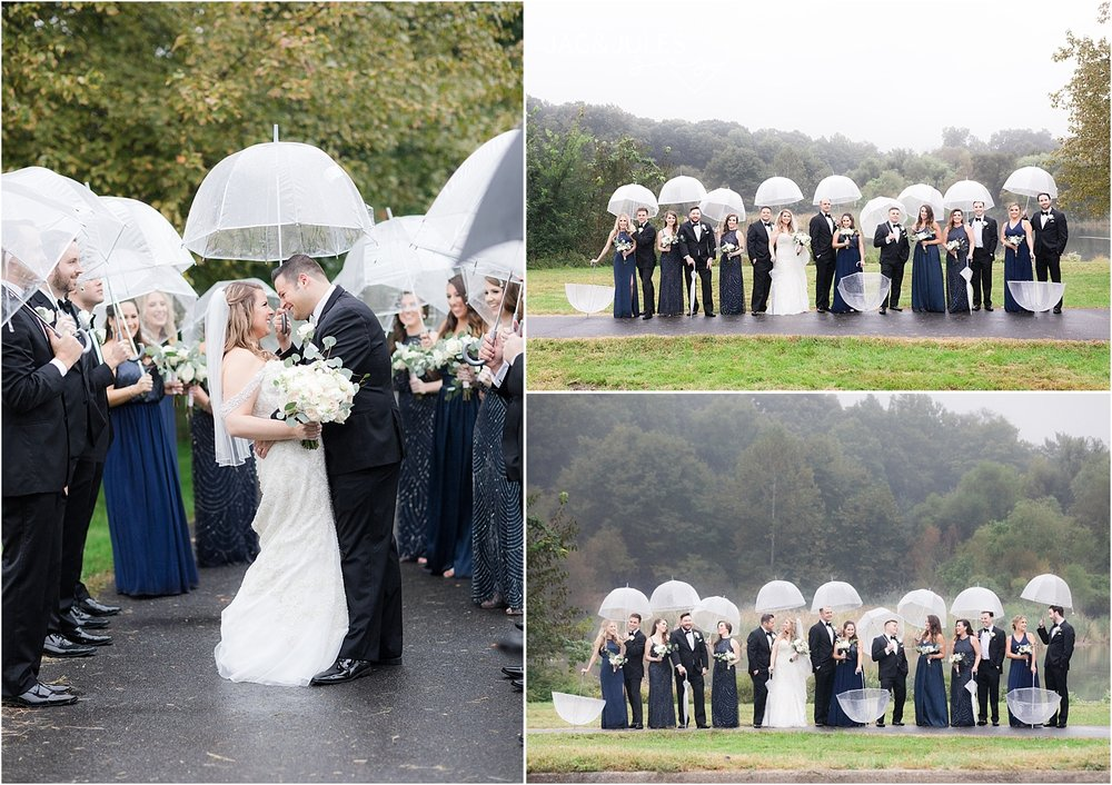 fun bridal party photo in the rain using umbrellas