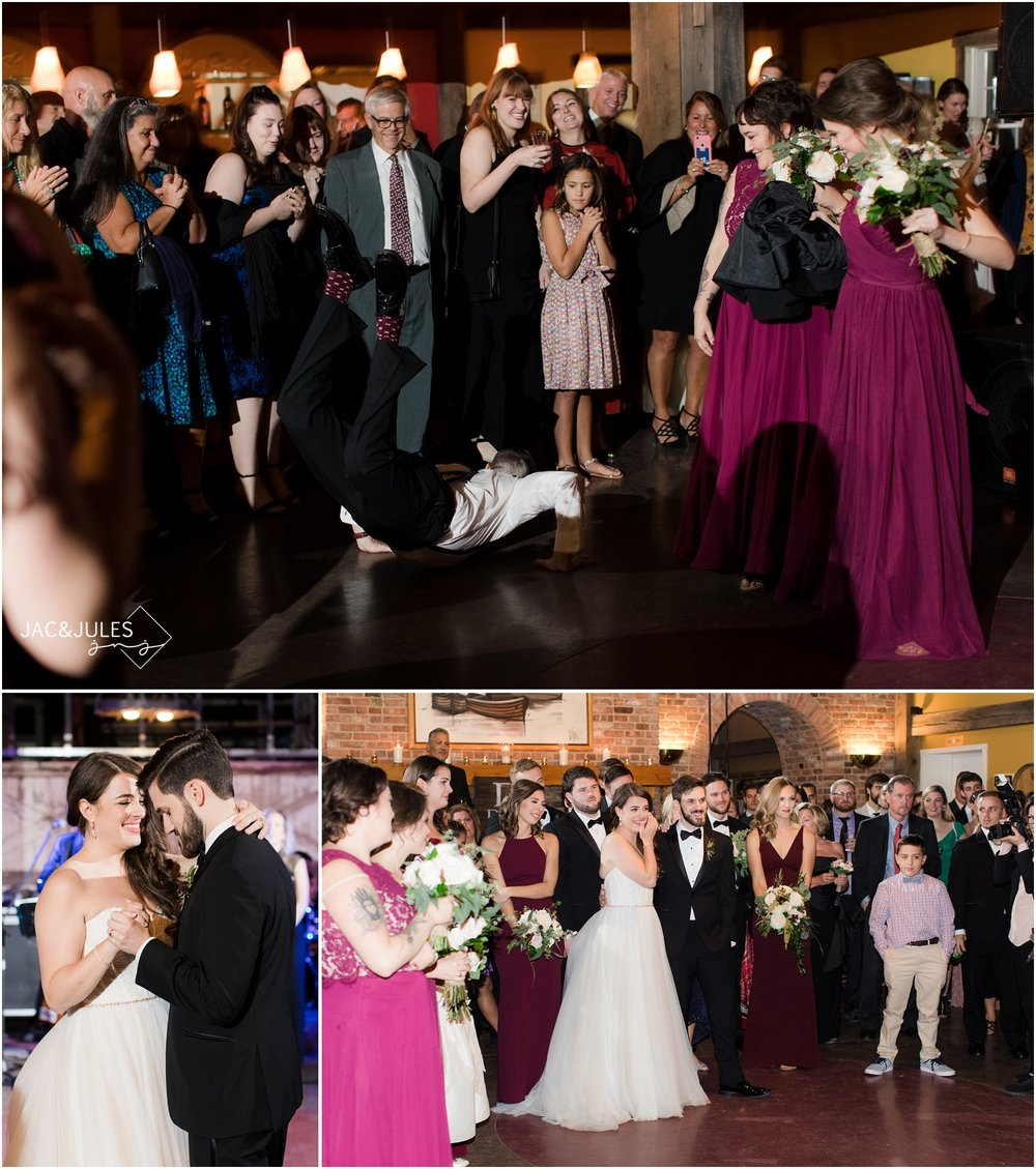 Groomsman doing the worm during reception entrances at Laurita Winery.