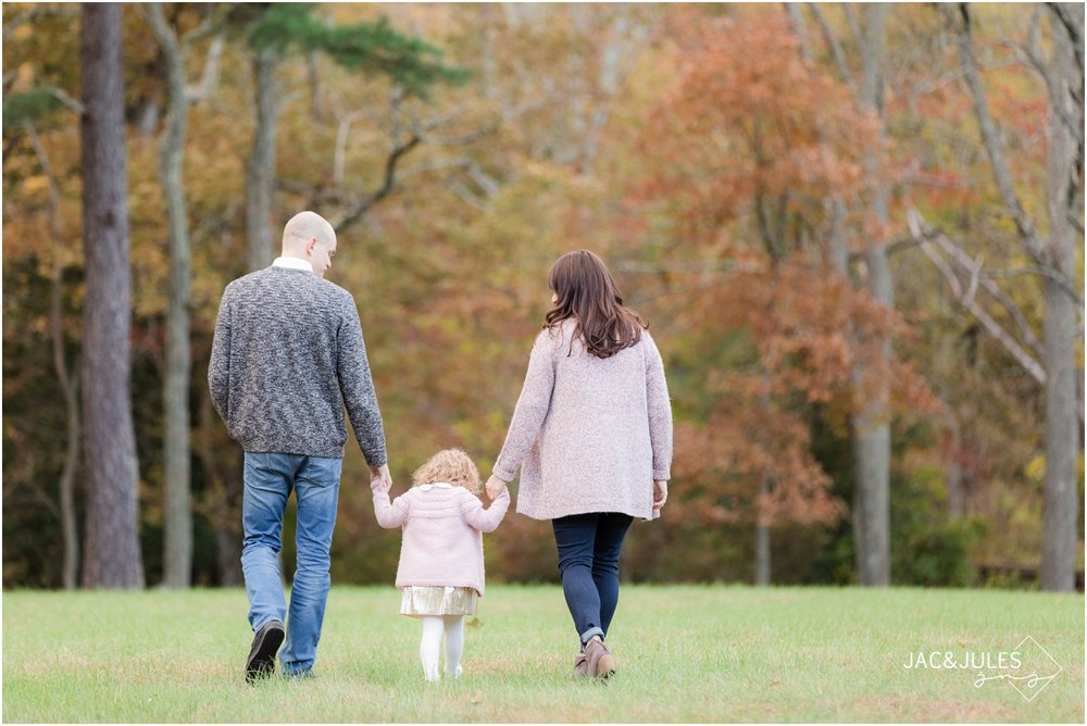 Photo of family walking in Fall foliage at Allaire State Park.