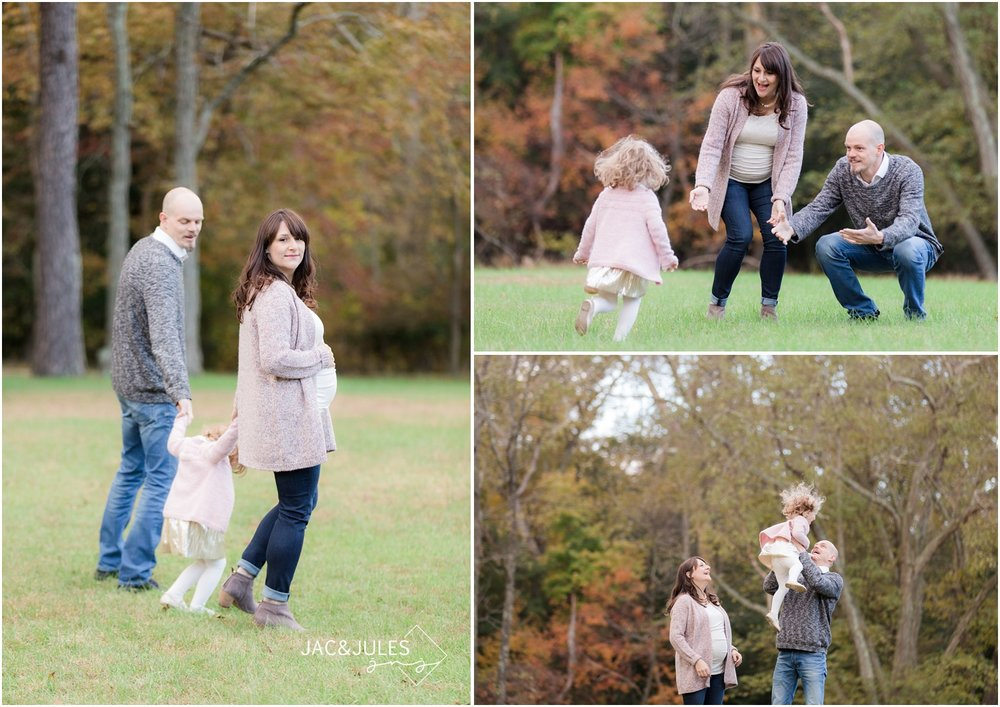 Photo of family playing in Fall foliage at Allaire State Park.