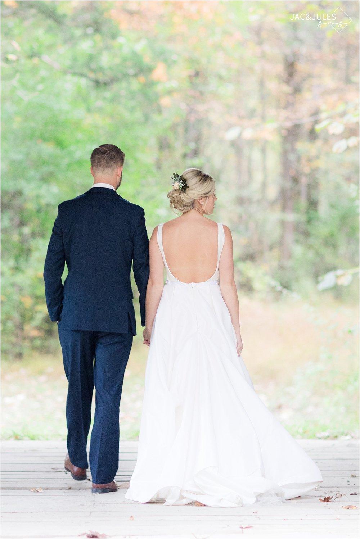 bride and groom walking at covered bridge barn in germantown NY