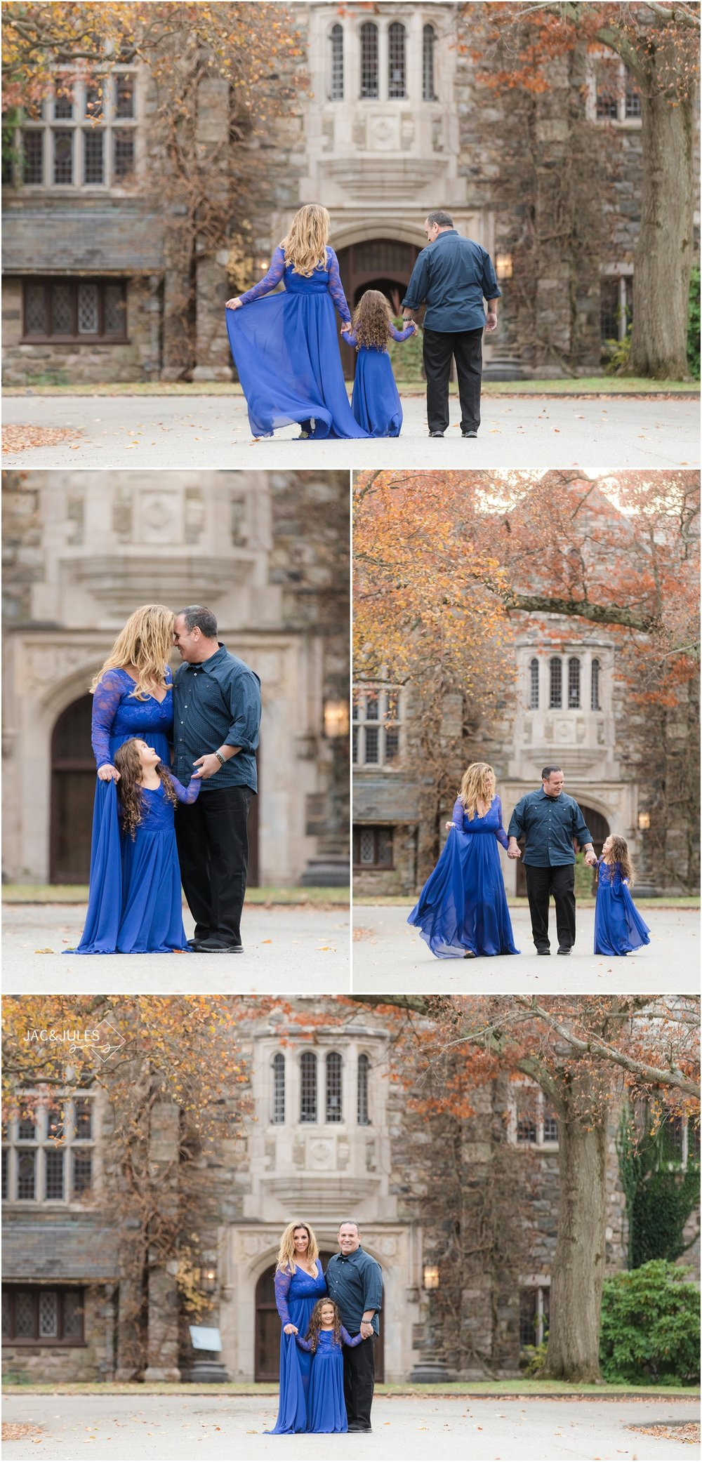 Family of three with flowing blue dresses in front of the castle at Skylands Manor in Ringwood, NJ.