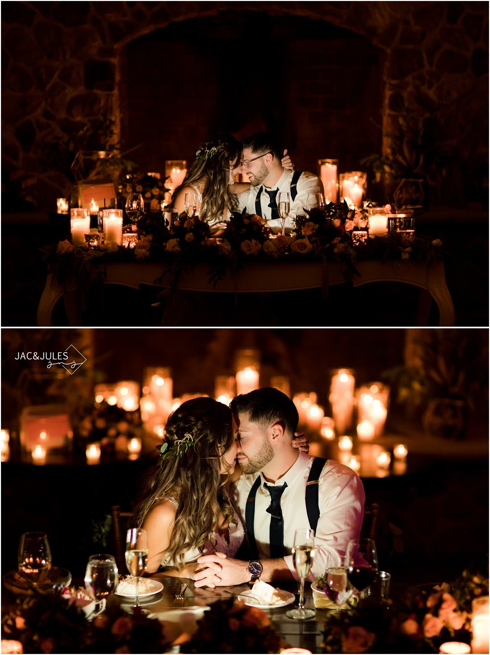 romantic candlelit photos of bride and groom at sweetheart table in front of the stone fireplace at the ryland inn.