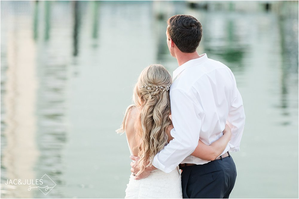 photo during sunset of a bride and groom at the reeds in shelter haven cape may