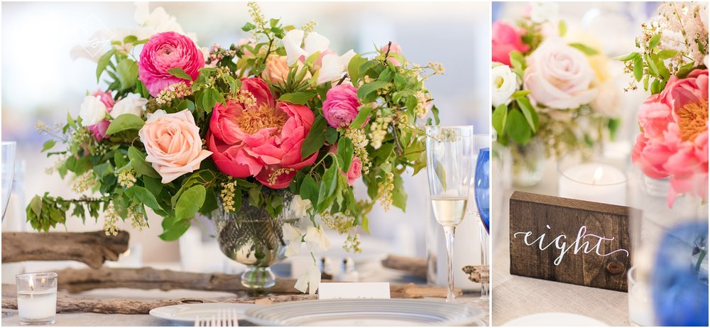 Floral centerpieces with driftwood and wooden table numbers for a wedding reception at Mantoloking Yacht Club