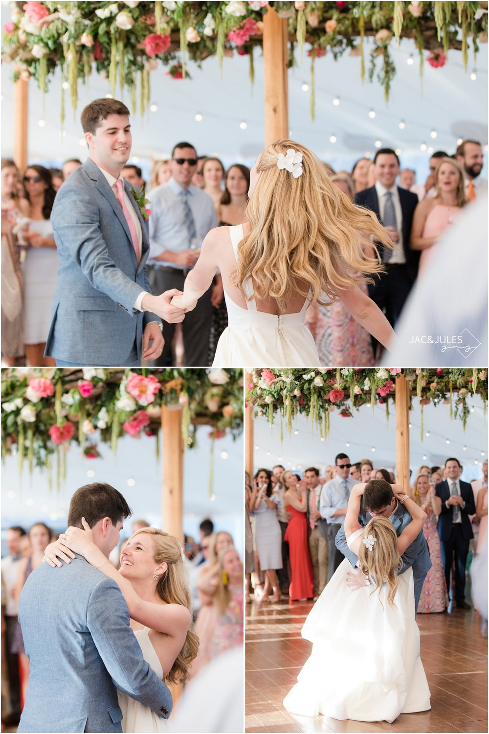 Bride and groom share their first dance at Mantoloking Yacht Club wedding reception under Floral wreath by Faye and Renee.