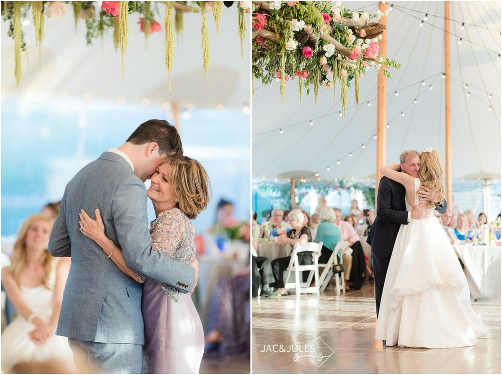 Bride and groom share parent dances at Mantoloking Yacht Club wedding reception under Floral wreath by Faye and Renee.