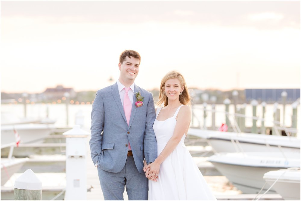 Wedding photo on the dock at Mantoloking Yacht Club at sunset.