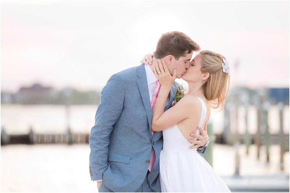 Couple kissing on the dock at sunset at Mantoloking Yacht Club published in New Jersey Bride Magazine.