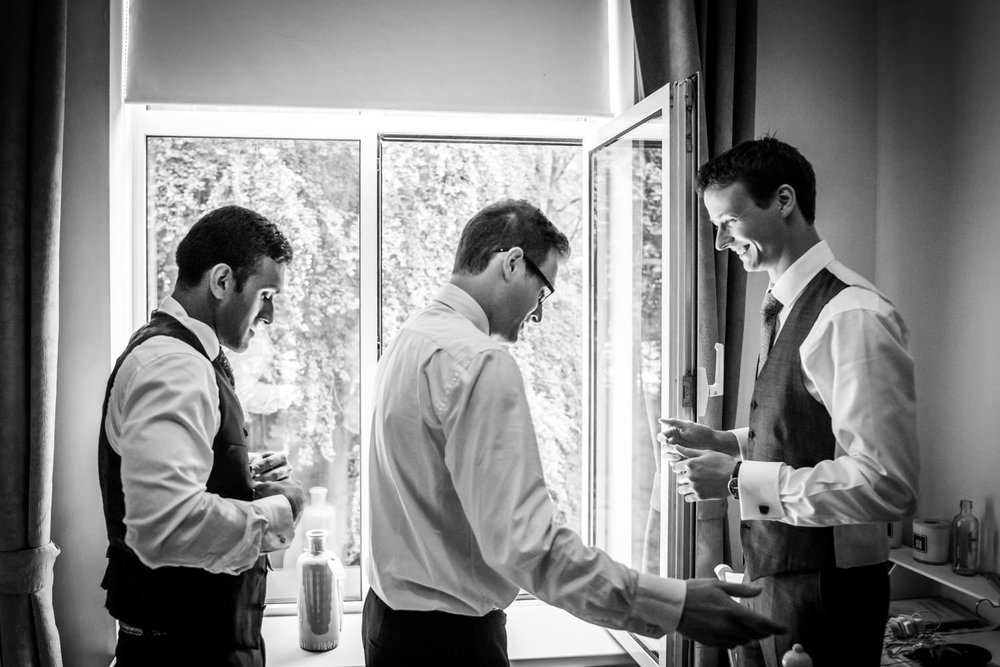 Groom is getting ready, with his best men.