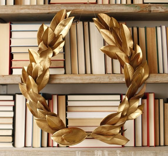 Laurel Wreath - I simplified this project by buying a large wire wreath frame and gold leaf picks, these would be beautiful. Starting at the bottom of the wreath form I attached the leaf picks with floral wire almost to the top and then cut with wire cutters the top exposed wreath frame. I added a 4