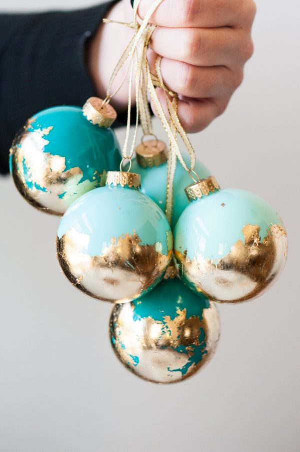 Gold Leaf Ornaments - This project is so easy and they look expensive. The only downside is waiting for the paint to dry takes some time. Clear glass ornaments can be found here.These would make great hostess gifts!