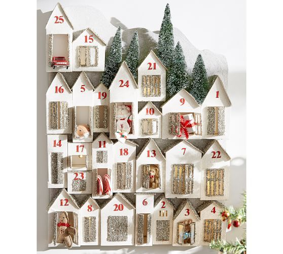 Glitter Houses Advent Calendar - I was inspired to recreate this advent calendar that I saw on Pottery Barn that was too rich for my blood. I purchased 2 sets of cardboard houses.Since these houses came without bottoms I hot glued heavy card stock to the bottom. I glammed these houses up with some paint and glitter. Once dried I applied sticker numbers on them and hung them on the wall with command hooks. You can put little trinkets, notes or candy in the doors of these cute houses for your little loves to discover.