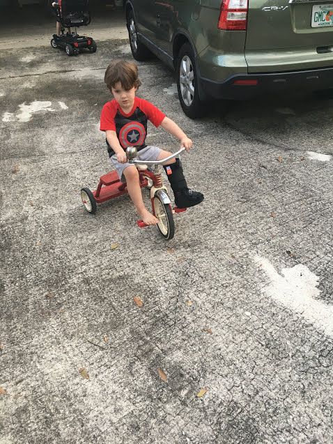 B on trike with boot.JPG