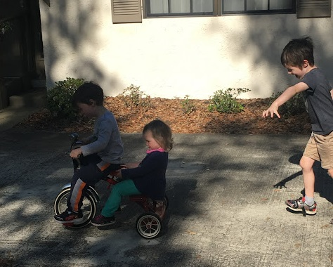 J chasing O and B on tricycle.JPG