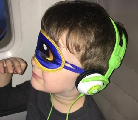 B with sleep mask plane.JPG