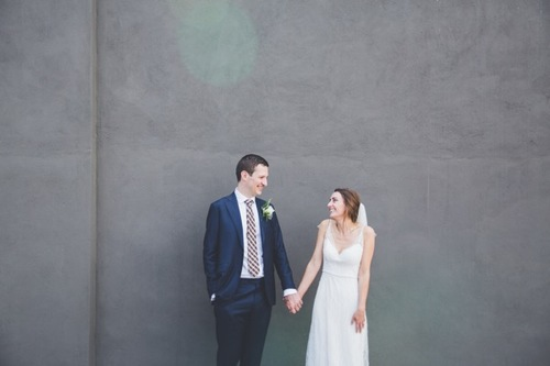 """I was so so happy with our beautiful photos from our wedding. I really feel like Kate captured the feeling and vibe of the whole day so well. Her and John were so easy to have around and they fitted in effortlessly, it was such a great idea to go and use a wall in a carpark for our backdrop for photos, I never would have thought of that but it worked so well and was such quick thinking. My mum in particular is proud as punch and been showing anyone she can our highlights!""  SARAH & MIKE"