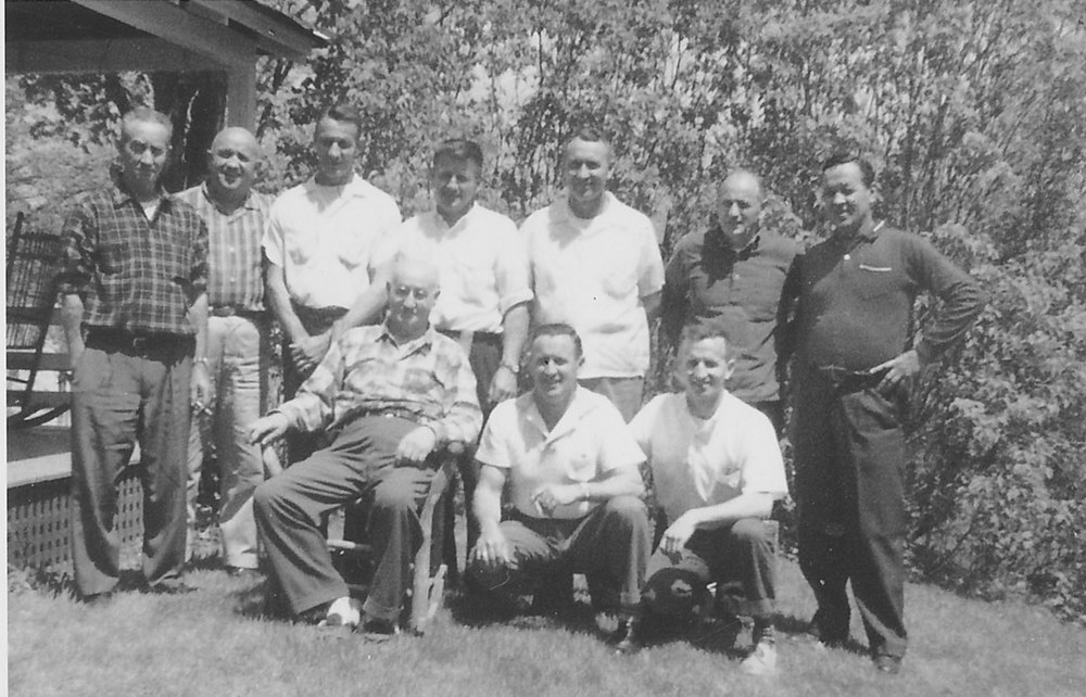 Bert and the nine Fortier Brothers next to the porch