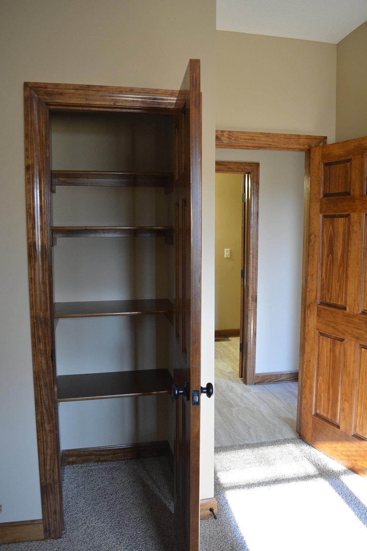 AFTER: Custom closet storage in Master