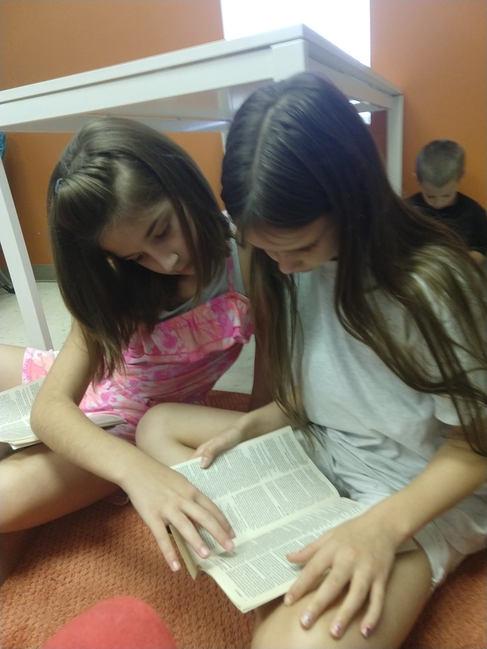 We love it when our students help each other read the Bible!