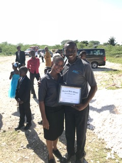Pastor Nesly and his wife Yvenide with his certificate of graduation from the HTC