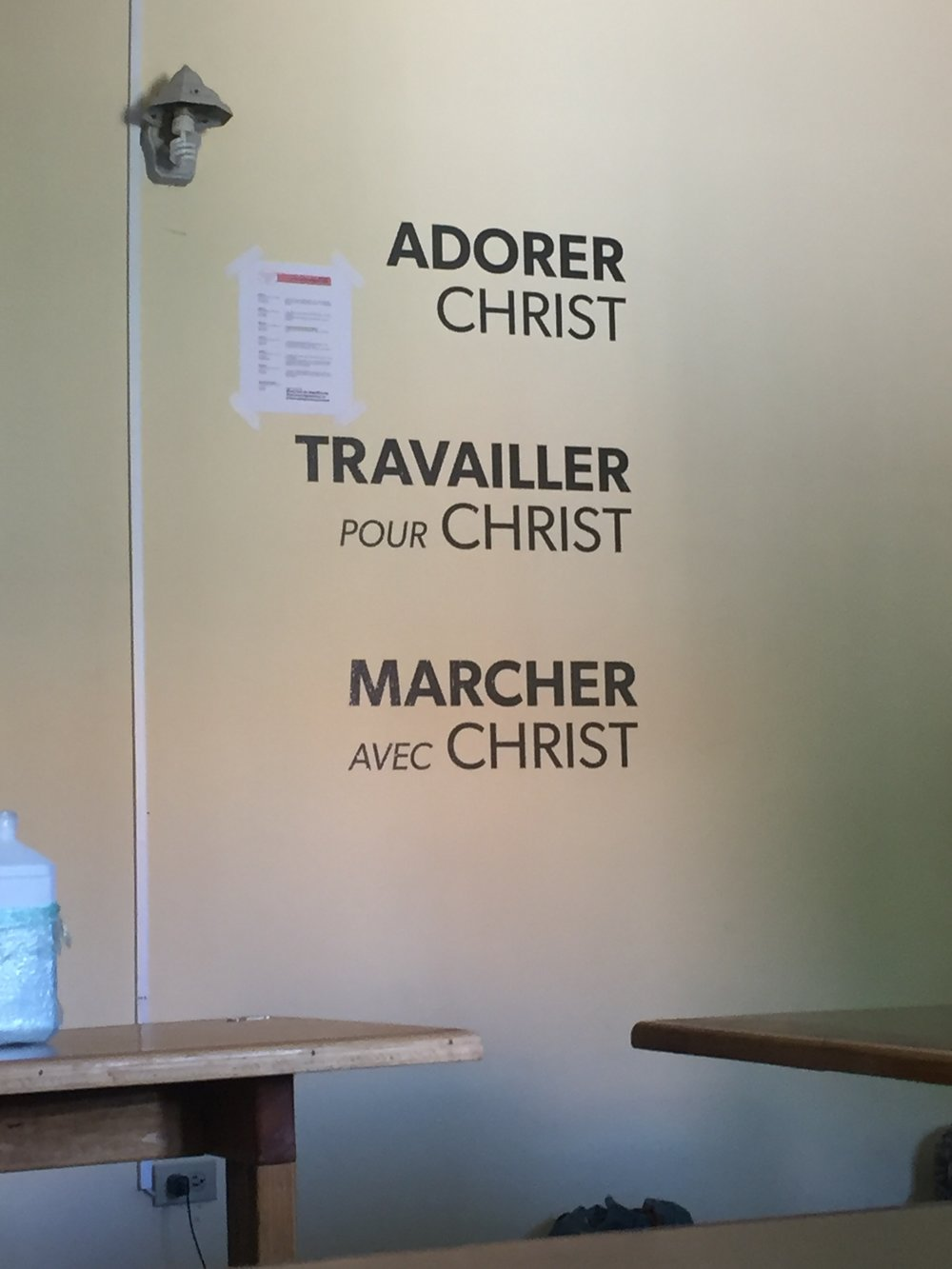 "French translations of the Harvest Pillars ""Worship Christ,"" ""Work for Christ,"" and ""Walk with Christ"" in the Training Center"