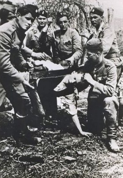 Ustaše_sawing_off_the_head_of_a_Serb_civilian.jpg