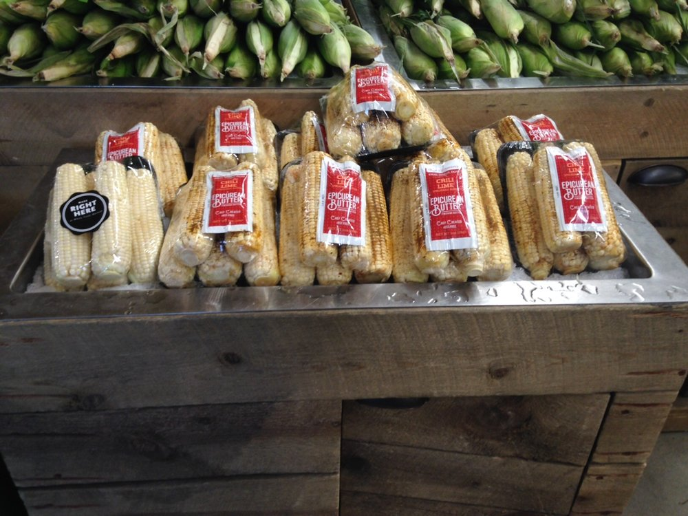 """You can now buy """"Kickin' Up Corn"""" at all Rocky Mountain Whole Food locations. Choose a pack of sweet corn coupled with single-serve packets of Garlic Herb, Chili Lime, or Black Truffle Butter. Great for cooking over a campfire!"""
