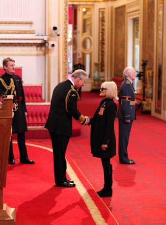 Barbara being presented, with an honor by HRH The Prince of Wales and displaying the honor. Photo source: http://www.jannaludlow.co.uk/Biba/NY_Honours.html