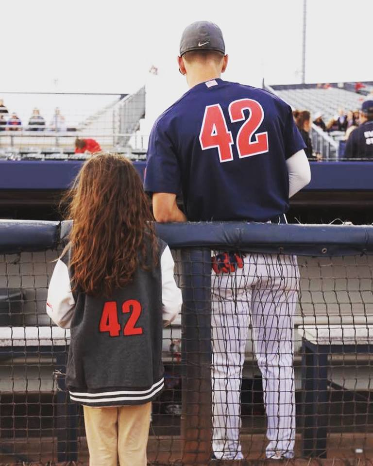 Maddie showing off her new jacket before an Arizona Baseball game.