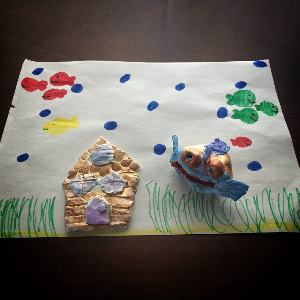 """A """"home"""" my daughter drew for some clay projects she made at school"""