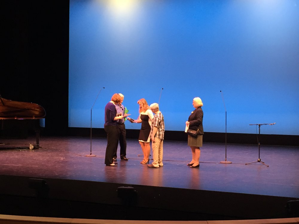 Participants of Sensory-Friendly Open House check out the view from the stage