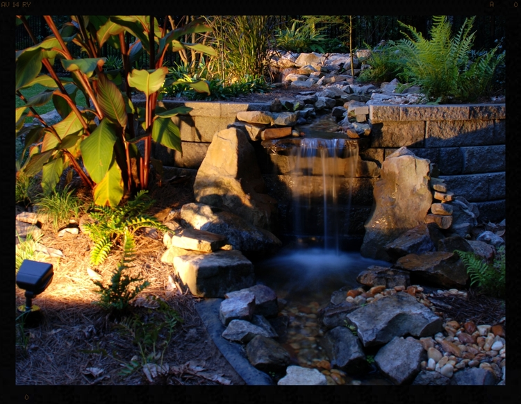 lush beautiful low coltage lighting in tallahassee with water features and patio pavers.jpg