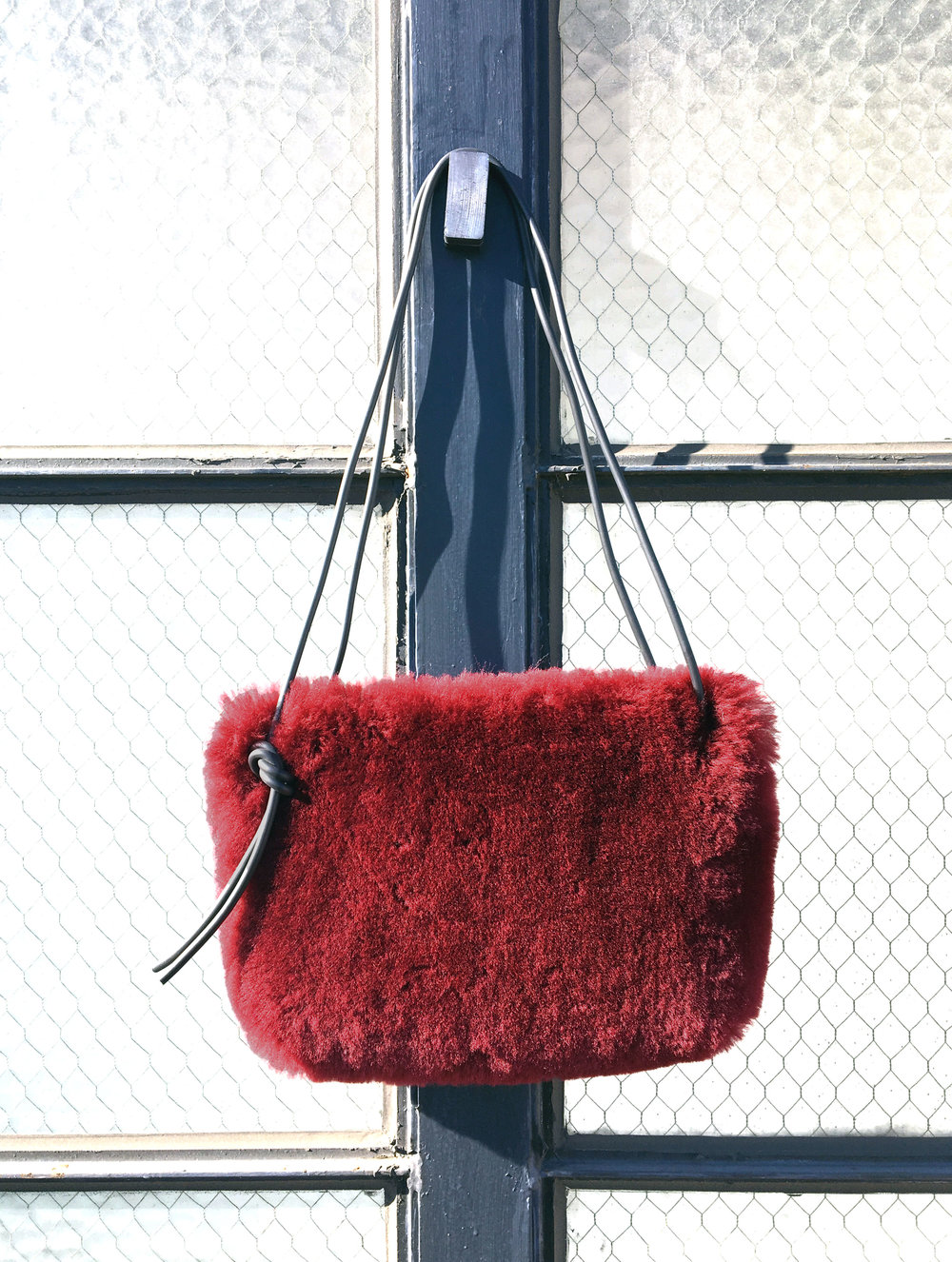 maroon shearling bag