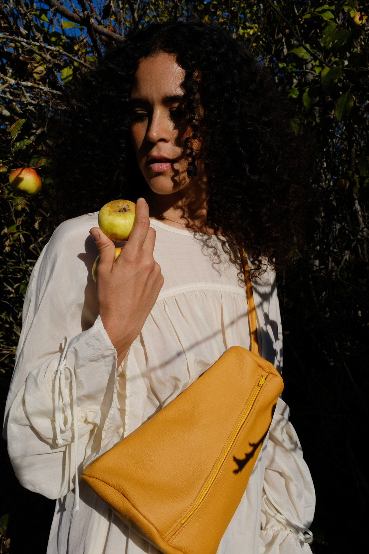 Turmeric soft leather sling purse
