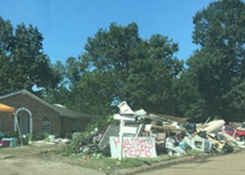 "People making light of a difficult situation - ""Hoarder's Rehab"" sign"