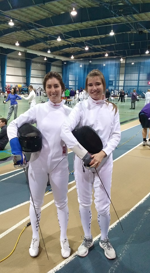 Carley Ort (left) and Sasha Zanina (right) fencing at Royal Military College (RMC)