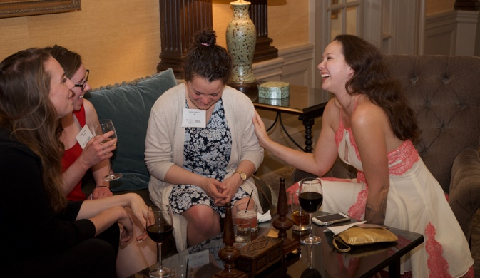 Neuroscience students laugh together in a not so quiet corner of the bar room
