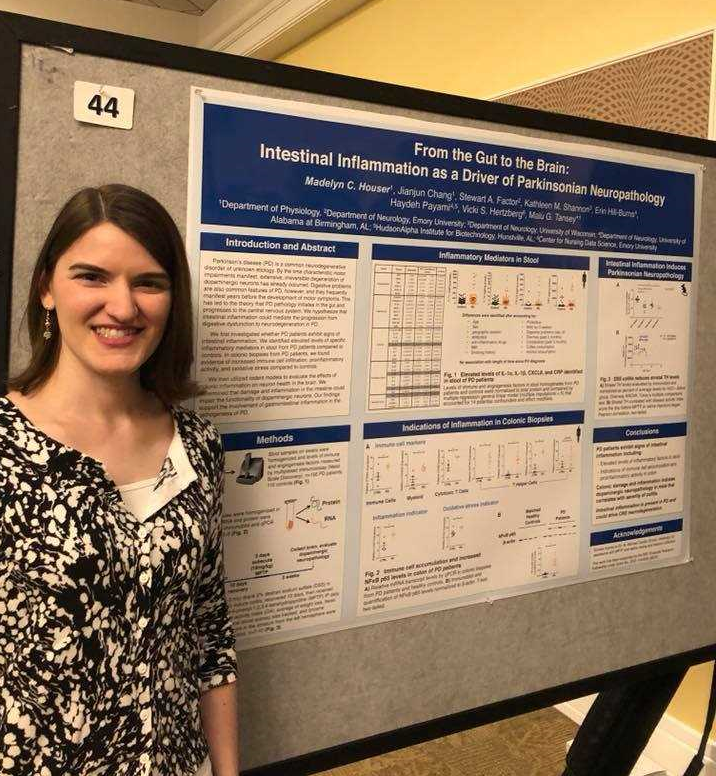 Madelyn Houser pictured next to her winning poster.