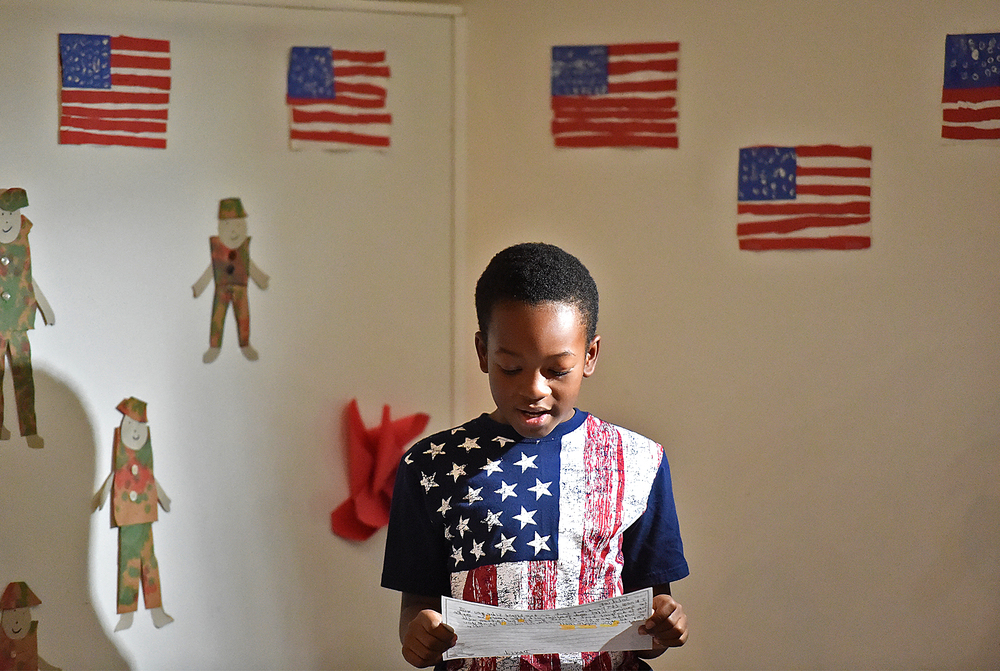 "David Sheppard, 9, a third grader at Trevose Day School, home of Neshaminy Montessori, reads aloud his thank-you letter to local veterans during a program at the school in Lower Southampton on Tuesday, Nov. 10, 2015 ahead of Veterans Day, Nov. 11. Sheppard's letter ended with ""You inspire me!!"""
