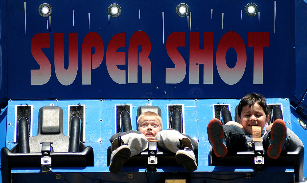"Christopher Frank, 8, of Northampton, middle, rides the ""Super Shot"" tower at the Lower Southampton Athletic Association annual carnival on Sunday, April 26, 2014."