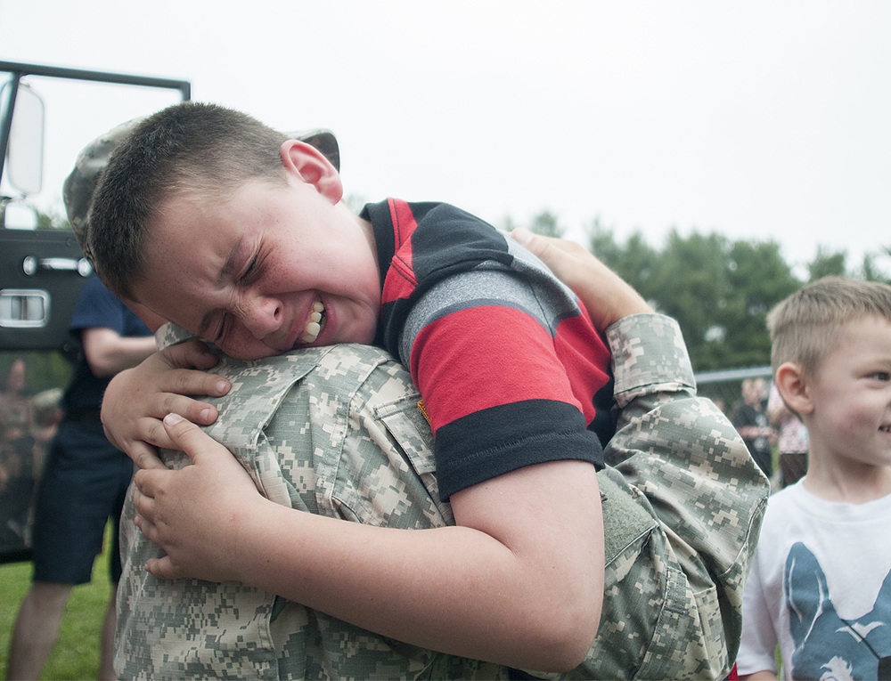 Len Cassidy III, 11, a 5th grader at Lower Southampton Elementary School, is overcome with emotion while hugging dad, Staff Sergeant Len Cassidy, 35, during a surprise homecoming on Monday, May 18, 2015, in which Principal Michelle Burkholder organized a routine fire drill for Sgt. Cassidy, who has been deployed for over a year, to arrive via firetruck.