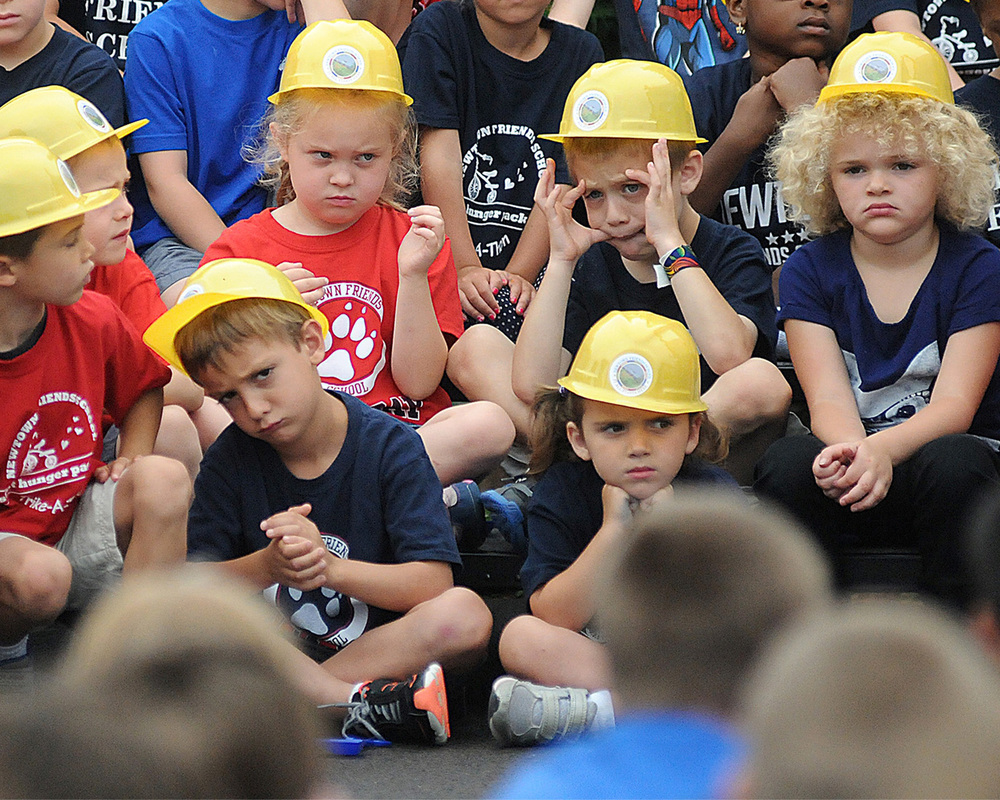 Newtown Friends School pre-kindergarteners and first graders fidget during the presentation before the groundbreaking for for their new construction project on at the school on June 9, 2014.