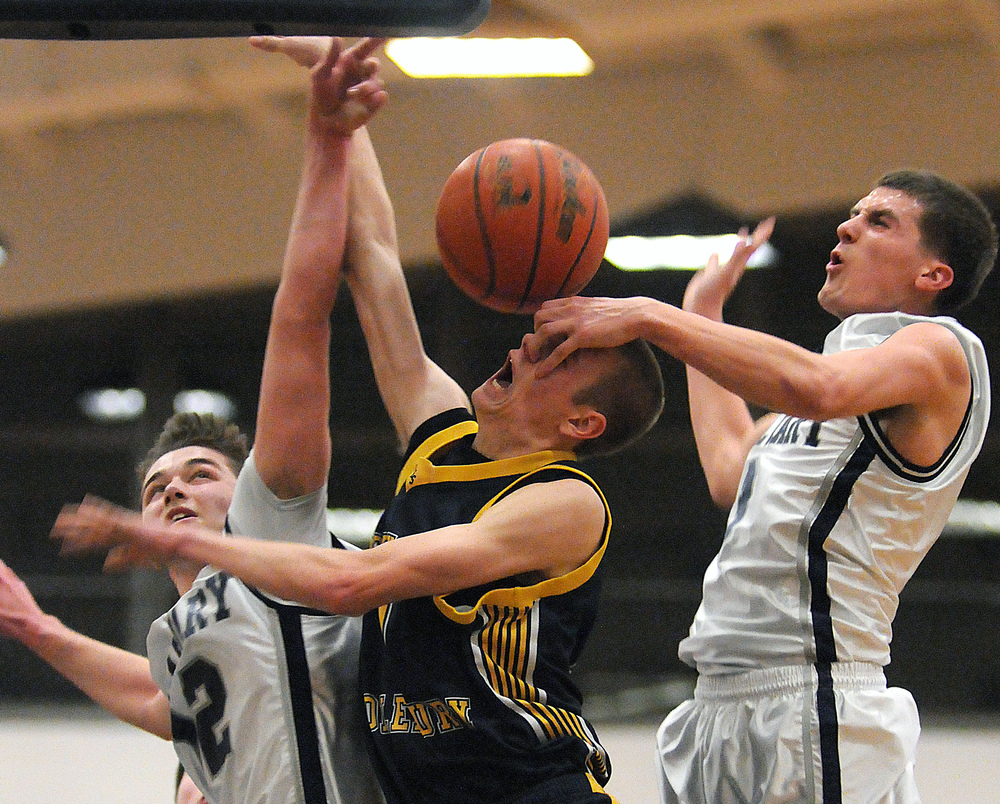 Calvary Christian's Sam Bair (12) and Jonathan Boback (3) try to block New Hope-Solebury's Jack Dougherty (1) from making a shot during New Hope-Solebury's three-point loss to Calvary Christian on Tuesday, Feb. 25, 2014 at Cheltenham High School. Calvary won 58-55.