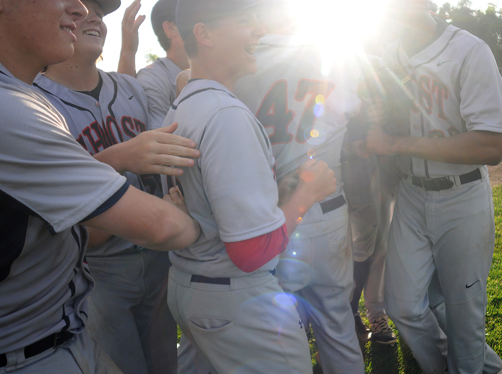 Holy Ghost Prep baseball players celebrate during their 12-1 District One final win against Sun Valley at Spring-Ford High School in Royersford on Wednesday, May 27, 2015.