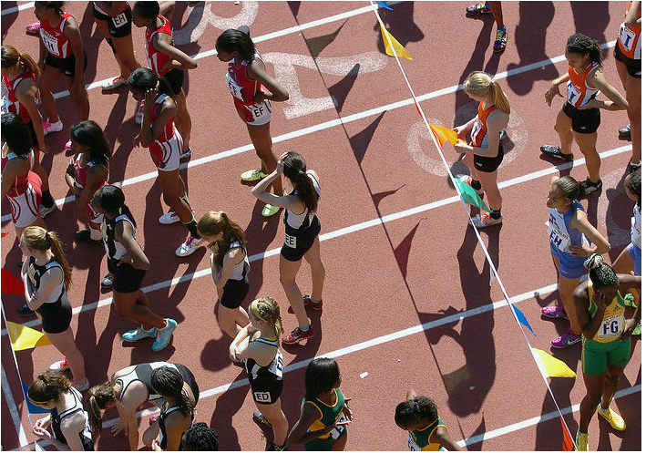 Girls competing in the Penn Relays line up before their races at the starting line at the University of Pennsylvania in Philadelphia on Thursday, April 24, 2014.