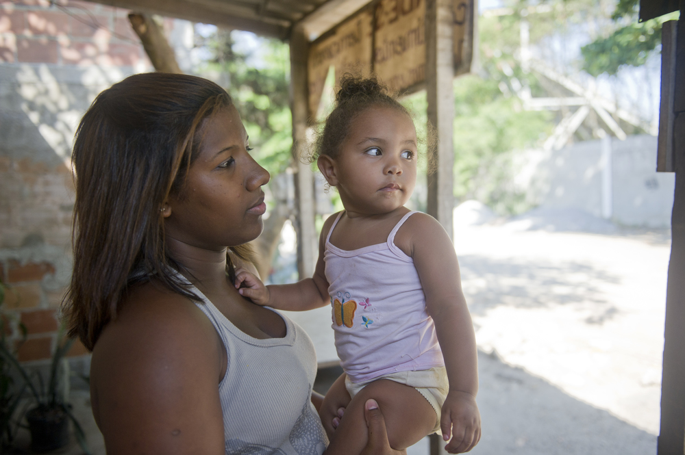 Wanessa Christine Quintiano, 17, plays with her baby cousin Ana Clara, 20 months, outside of their home in Vila Autodromo. Quintiano is of age to just be entering the workforce. Quintiano also said that all of her family and friends live in the favela. If she is forced to move, she will be taken away from everything she knows.